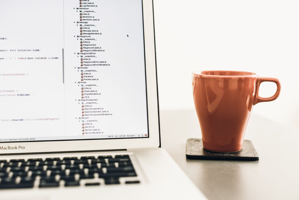 Laptop with a red mug to learn Excel online