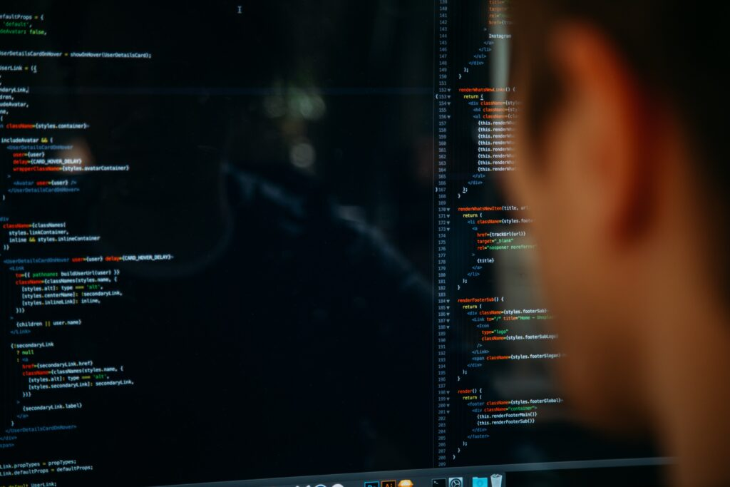 Person looking at a monitor with code written on the screen